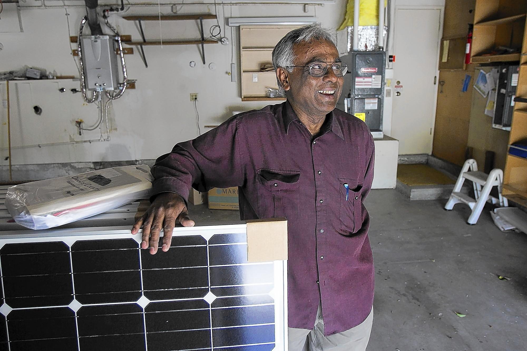 Durai Swamy, a homeowner in Huntington Beach, is upgrading his home to be as energy efficient as possible. An energy efficient furnace and tankless hot water heater have been installed and he is waiting to install solar panels on the roof.
