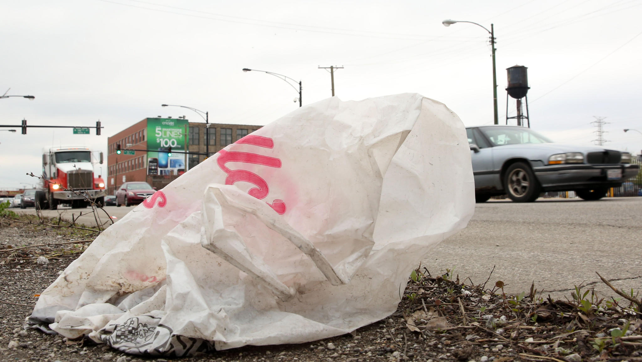 A plastic shopping bag lies along the road as traffic rolls northbound on Western Ave. between 17th and 18th streets near the Pilsen neighborhood on Wednesday.
