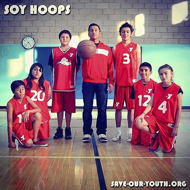 The Save Our Youth basketball team reached the finals of the Newport-Mesa YMCA 12- to 14-year-old division and finished second. The SOY team featured, from left: Julian Ribas, Sharon Ozuna, Rafa Hernandez, Eduardo Iniesta (Coach Eddie), Daniel Carrillo, Adrian Barajas and Vanessa Cornejo.