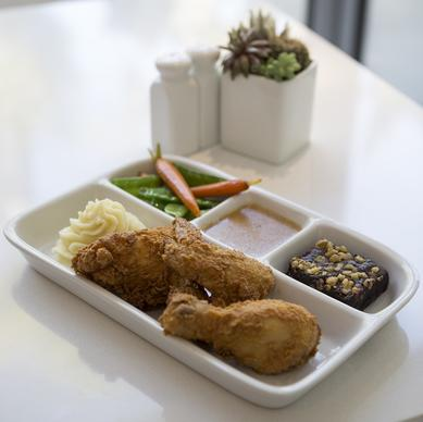 "TV dinner redo: ""The Brady Bunch,"" which features fried chicken, mashed potatoes with gravy, peas and carrots and a dessert brownie."