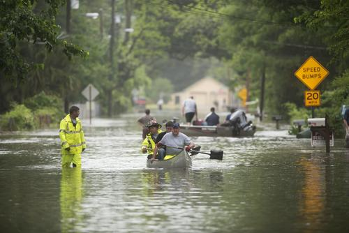 Rescue personal help residents out of flooding along Kelly Ave. in Pensacola, Florida, on April 30, 2014.