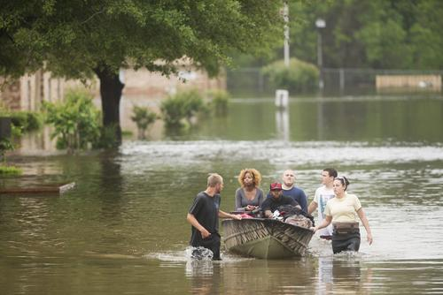 Residents of Forest Creek Apartments are rescued after heavy flooding in Pensacola, Florida, on April 30, 2014.