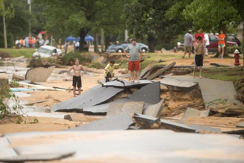Residents survey flood damage to the Cordova Park neighborhood in Pensacola, Florida, on April 30, 2014.