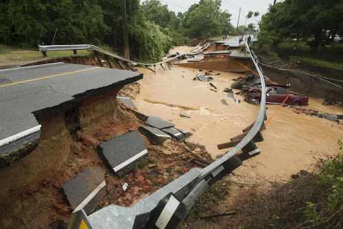 Damage due to flash flooding is seen along Johnson Ave. in Pensacola, Florida, April 30, 2014.