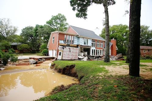 A collapsed home sits on Bayou Blvd. after heavy rains and flash flooding on April 30, 2014 in Pensacola, Florida.