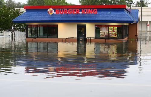 A Burger King sits in flood water on Brent Lane, one of the main roads in the city that was flooded out after heavy rains and flash flooding on April 30, 2014 in Pensacola, Florida.