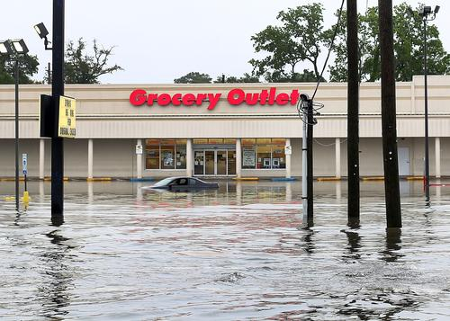 A car is submerged in flood water at a shopping center located on Brent Lane, one of the main roads in the city that was flooded out after heavy rains and flash flooding on April 30, 2014 in Pensacola, Florida.