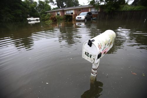 A mail box stands in a flooded neighborhood of Pensacola, Florida, April 30.