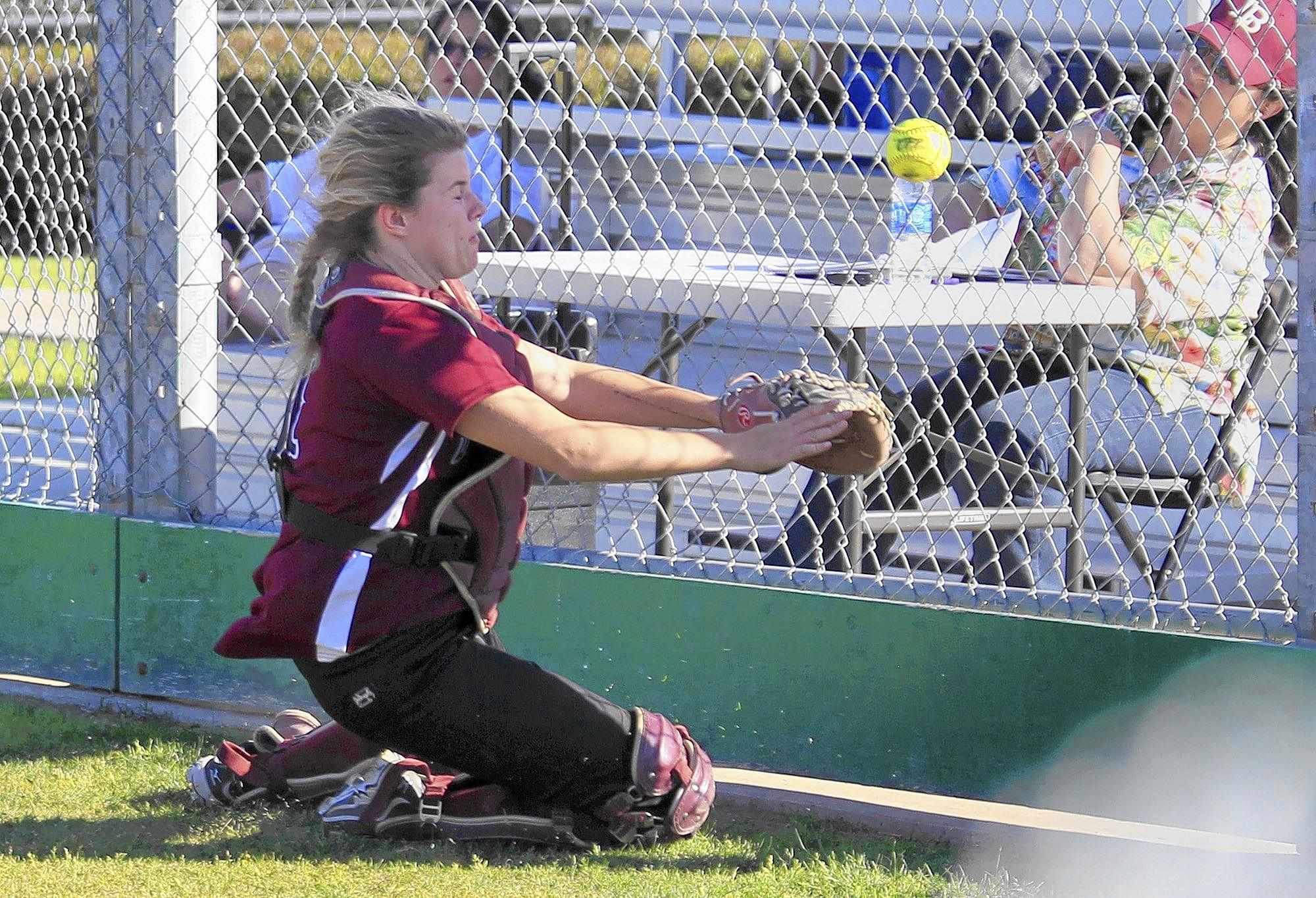 Laguna Beach High catcher McKena Collins hustles for a foul ball during an Orange Coast League softball game against Costa Mesa in Laguna Beach on Tuesday.