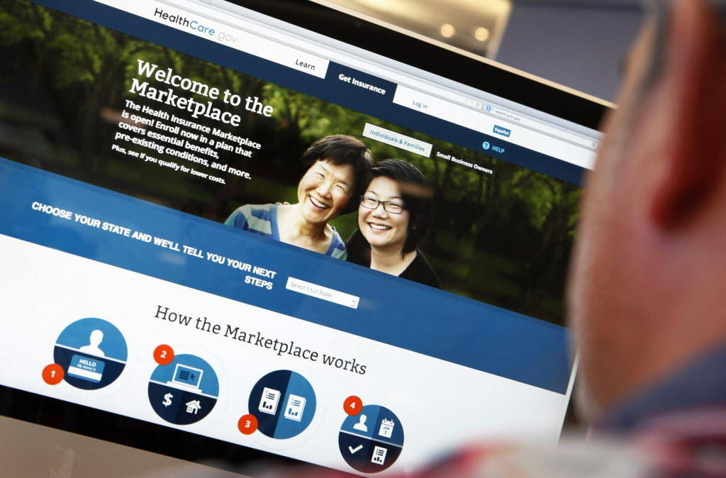 A man looks over the Affordable Care Act signup page on the HealthCare.gov website in New York.