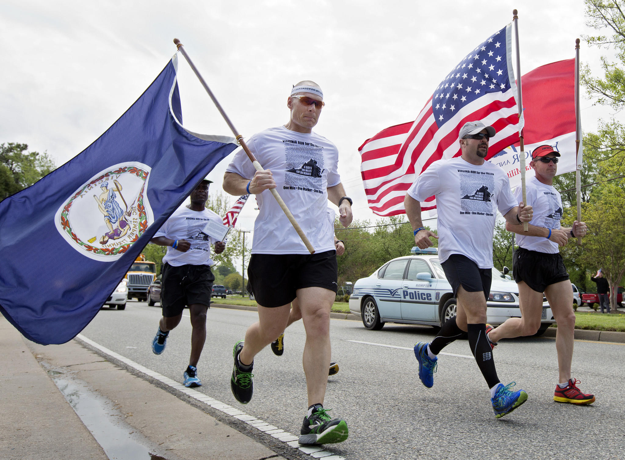 Runners travel down North Armistead Avenue as a part of the Virginia Run for the Fallen on Thursday in Hampton. Runners will carve a path from Fort Story to Arlington National Cemetery over the span of four days, stopping every mile to honor a fallen Virginia service member.