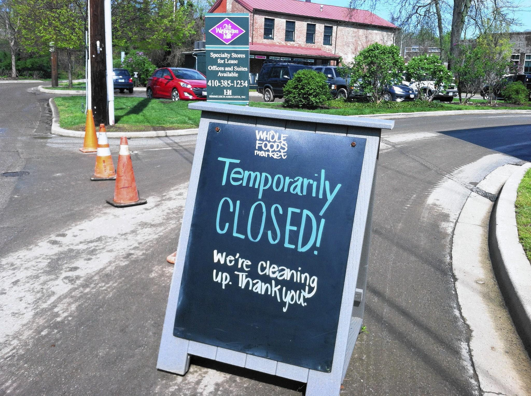 The enrtrance to Whole Foods in Mount Washington Mill is blocked off with a sign after heavy rain flooded the shopping center.