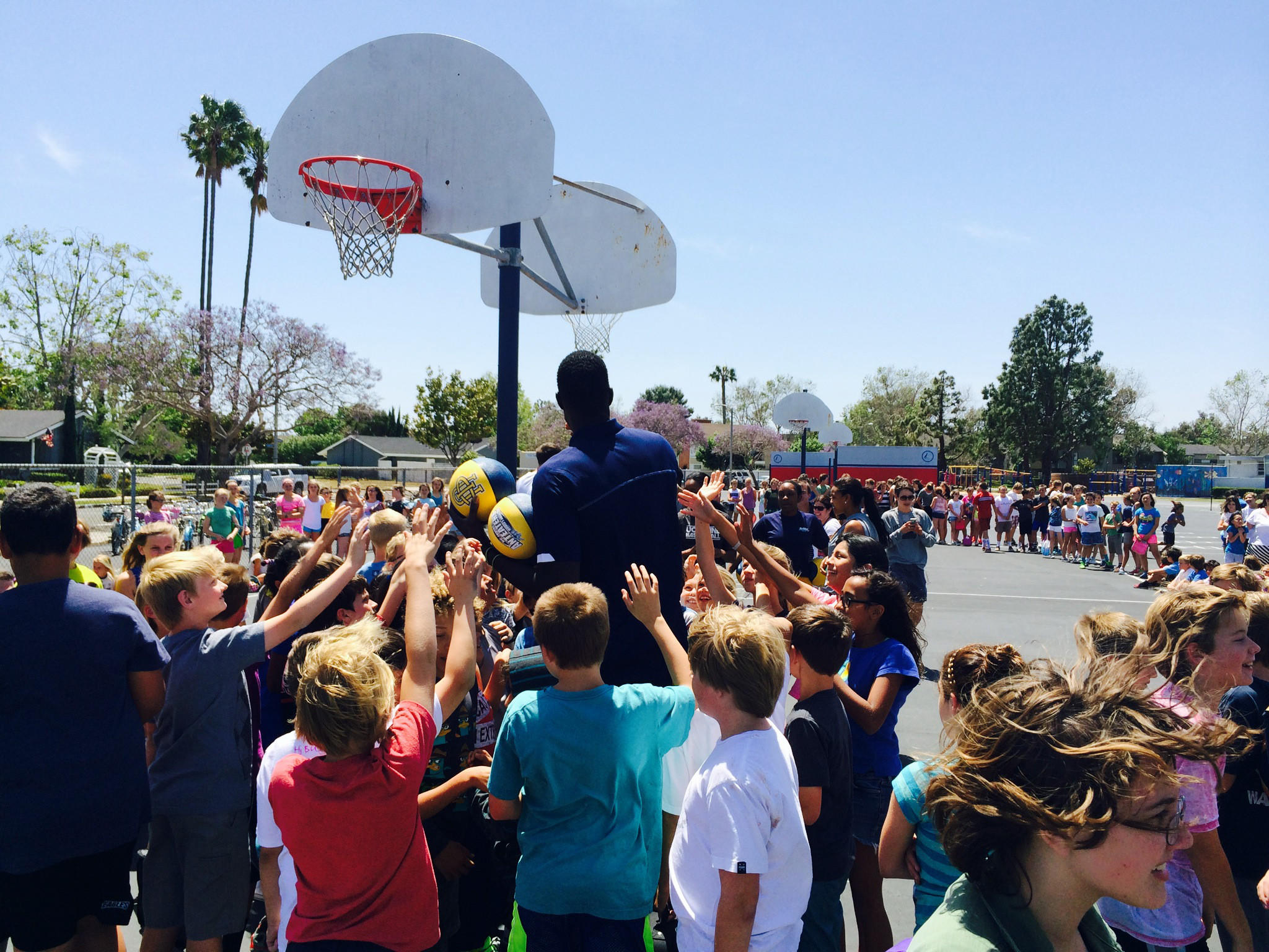Mariners Elementary School students surround Mamadou Ndiaye, UCI's 7-foot-6 center, at the Newport Beach campus Wednesday afternoon.