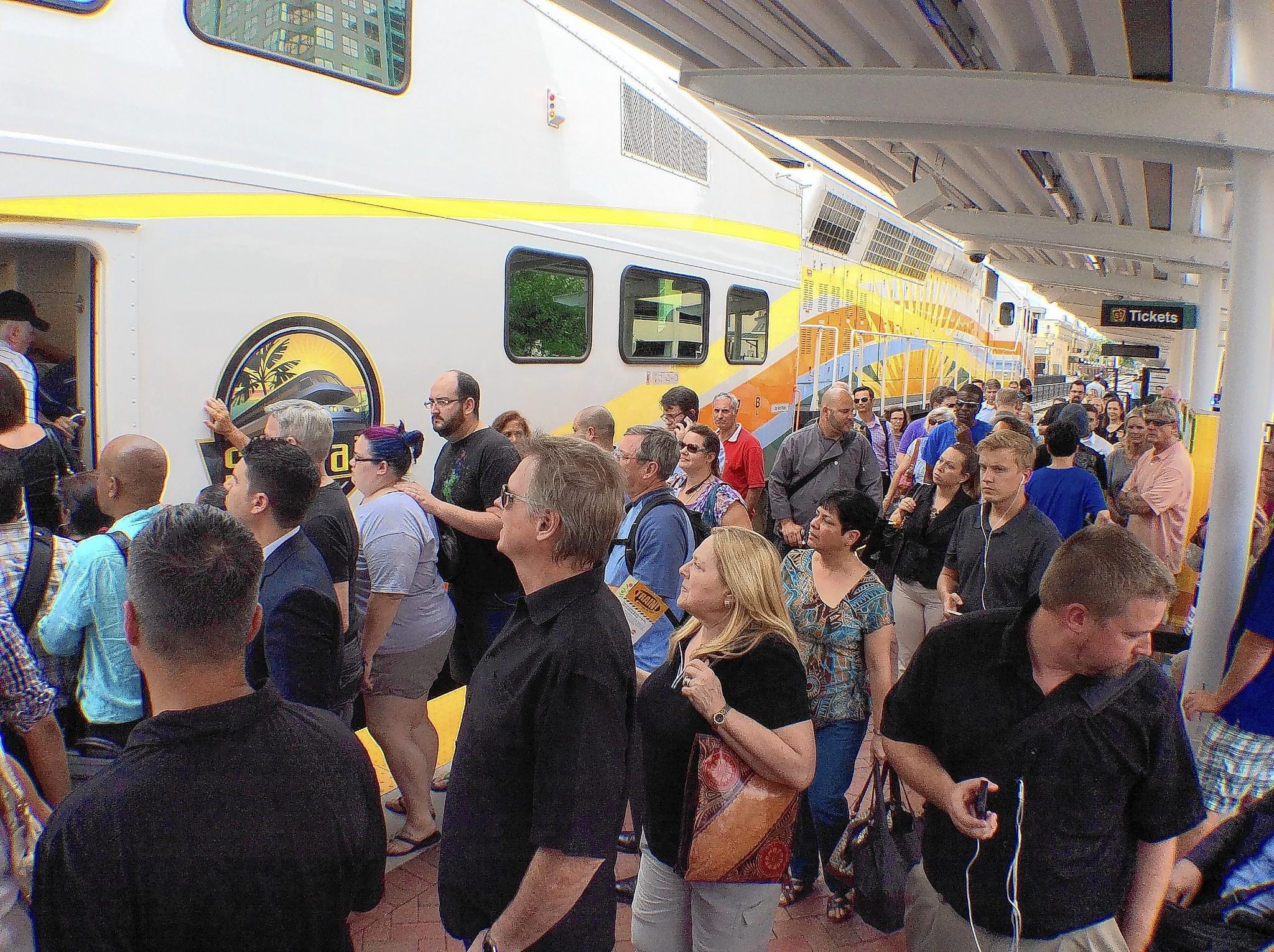 Evening commuter crowd the SunRail platform at the downtown Lynx station.