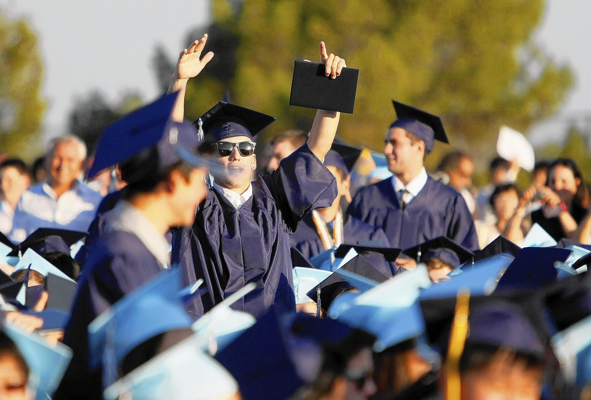 Crescenta Valley High School students celebrate during commencement in La Crescenta on Tuesday, June 4, 2013.