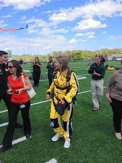 Superintendent Renee Foose shortly after parachuting 13,500 feet into the Atholton High School stadium with the U.S. Army's Golden Knights parachute team.