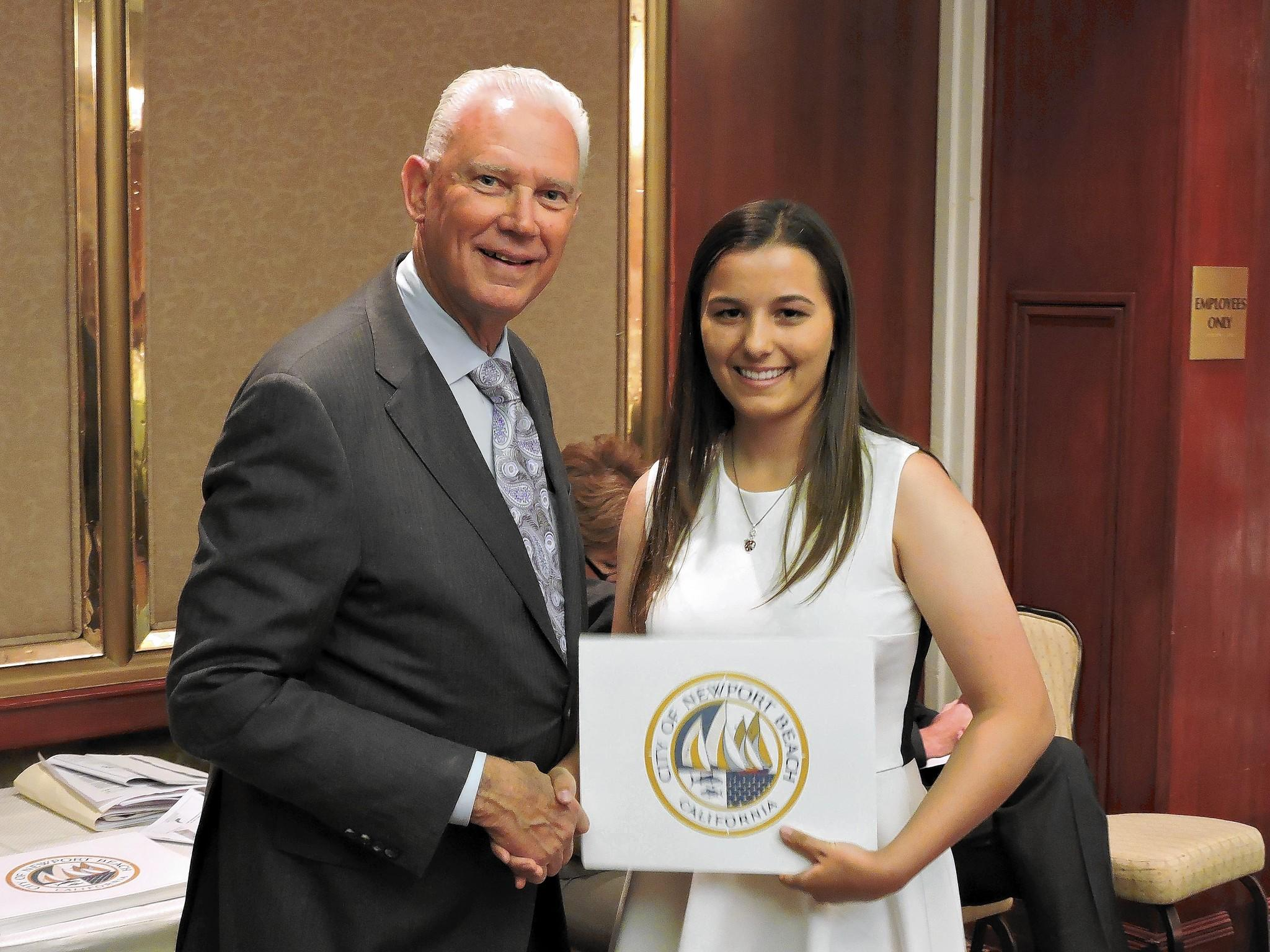 Newport Beach Mayor Rush Hill poses with Newport Harbor High School senior Natalie Cernius during the 53rd annual scholarship awards dinner hosted by the Newport Beach Chamber of Commerce and The Commodores Club.