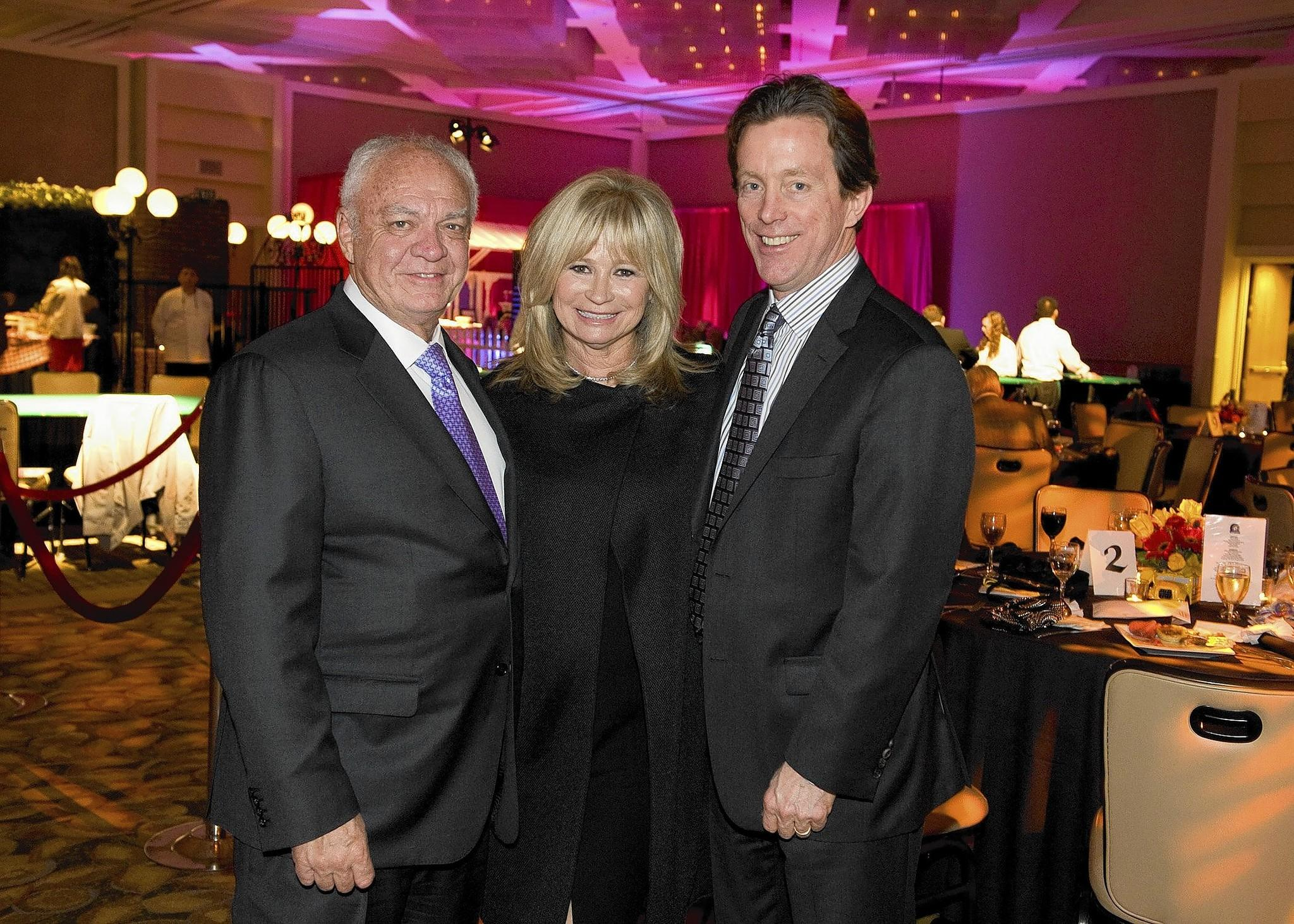 "Segerstrom Center for the Arts ""Bet on the Wheels"" gala honorees Mike and Eve Ruffatto with Center President Terry Dwyer."