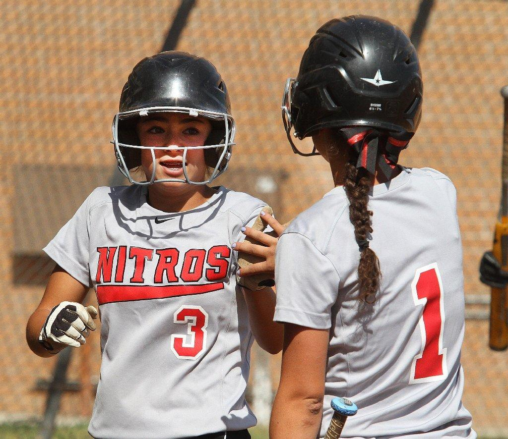 Sammy Fabian, left, and the Glendale High softball team defeated Crescenta Valley, 7-5.