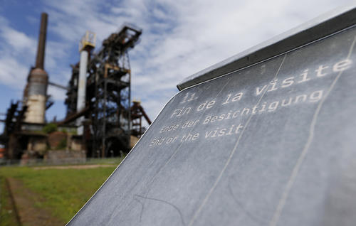 """A sign that reads """"end of the visit"""" is seen at the U4 museum in Uckange near Florange, France, May 11, 2013. The Uckange U4 furnace, stopped in 1991 after a century of production was turned into a museum in October 2007 as a testimony of the  forging and steelmaking tradition in the """"Angel Valley"""" of the Lorraine region. With a level of more than 10 percent unemployment, the Lorraine Region and its """"Angel Valley"""" is one of France's most impacted area. After the 2009 closure of nearby Gandrange, an ArcelorMittal steelworks in the region, the recent ArcelorMittal's decision to mothball two blast furnaces at its site in Hayange-Florange, increases the fear of the end of the forging and steel making tradition in the """"Angel Valley"""" of the Lorraine region, turning the valley into a """"Museum Valley""""."""