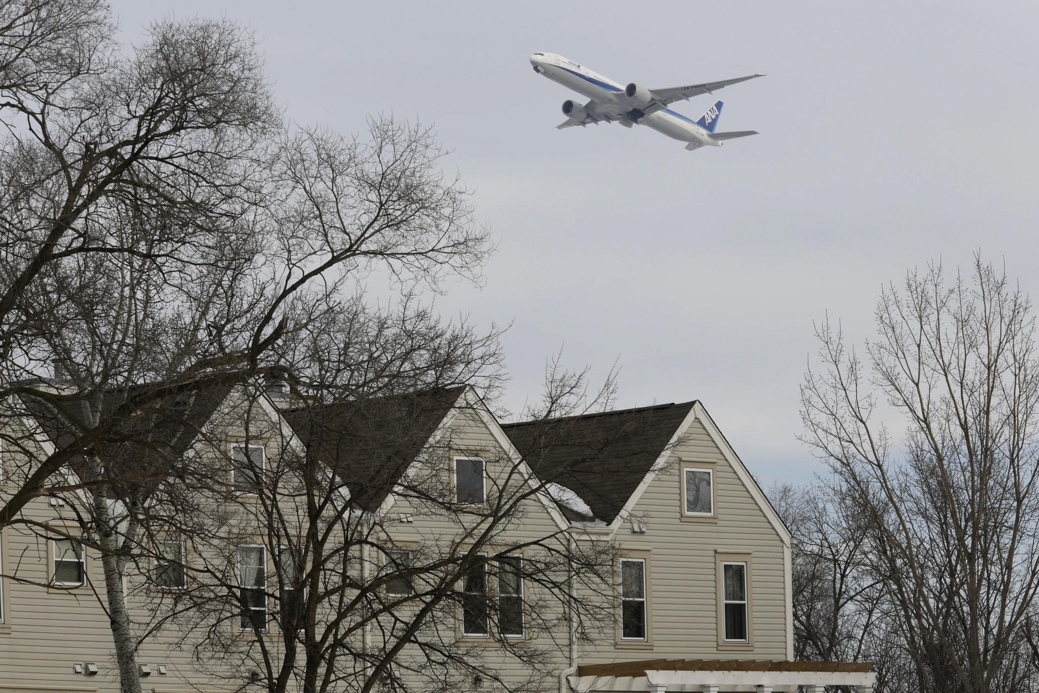A jet heads west from O'Hare over homes in Bensenville in January. Bensenville registered some of the most noise complaints in November 2013.