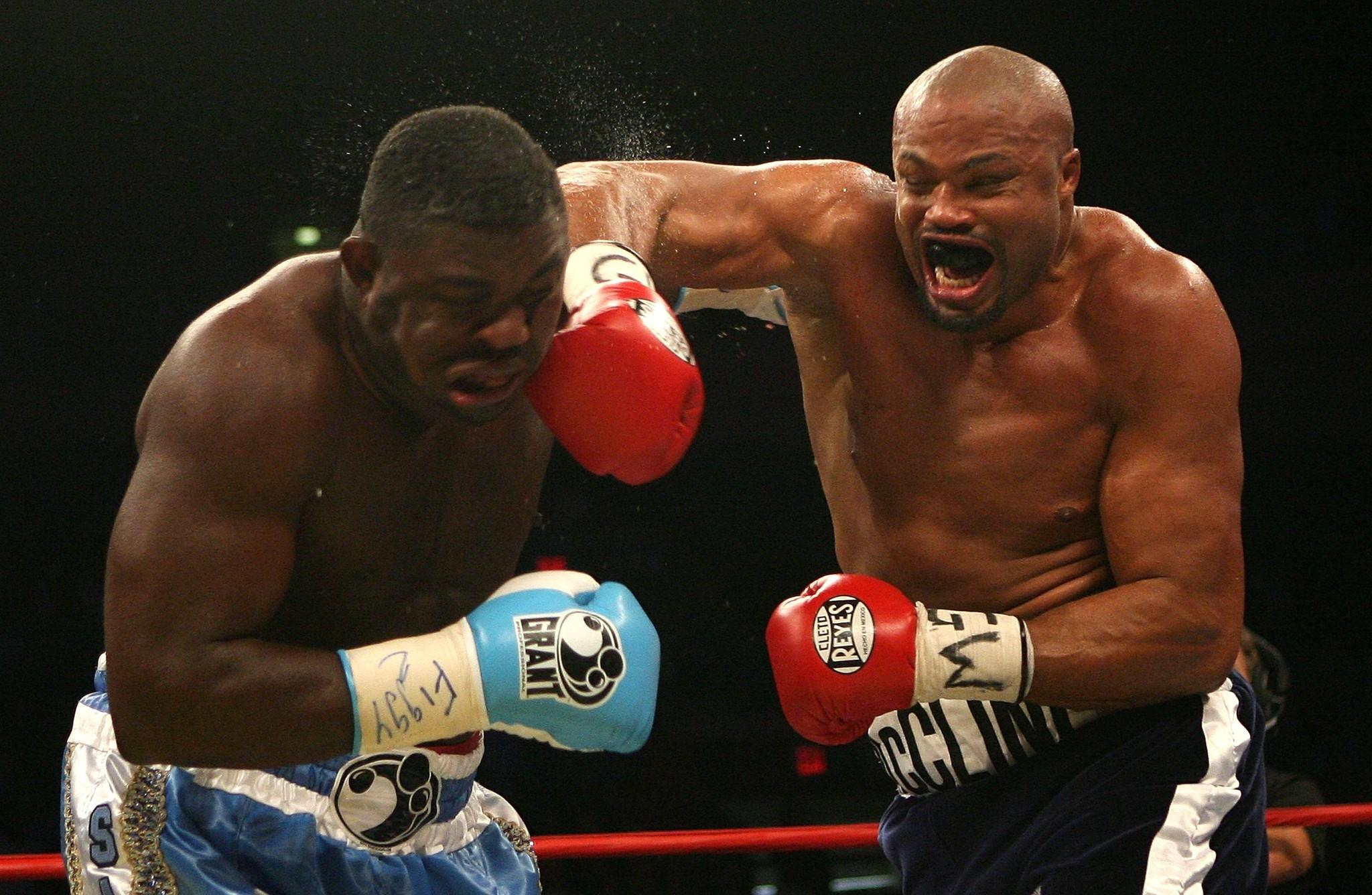 Jameel McCline lands a right on Samuel Peter of Nigeria during their WBC Heavyweight Championship bout on October 6, 2007 at Madison Square Garden in New York City. McCline, a former heavyweight champion, is challenging U.S. Rep. Alcee Hastings, D-Miramar, in the August 2014 Democratic primary. (Photo by Nick Laham/Getty Images)