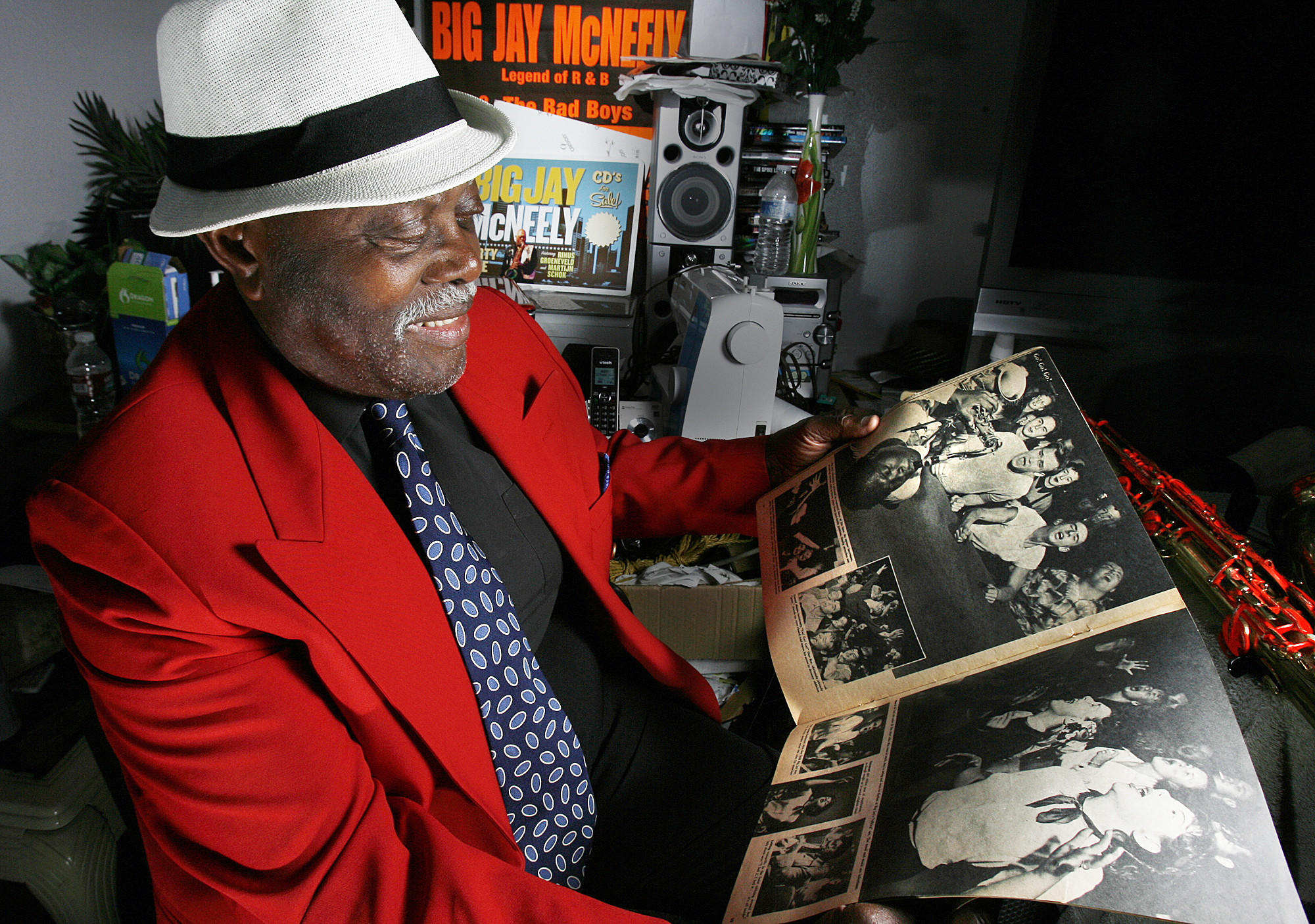 Big Jay McNeely holds a 1953 copy of See Magazine with a large picture of him playing saxophone on his back in Los Angeles on Monday, August 6, 2012. McNeely's first hit album was in 1949.