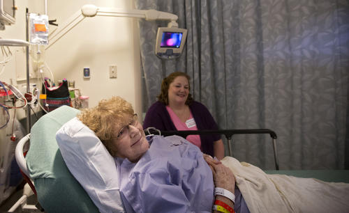 Judy Thomas, 74, waits with her daughter, Kristen Cayton, before undergoing surgery to fuse the sacroiliac joint at Mary Immaculate Hospital on April 17. The minimally invasive surgery is done to alleviate lower back pain.
