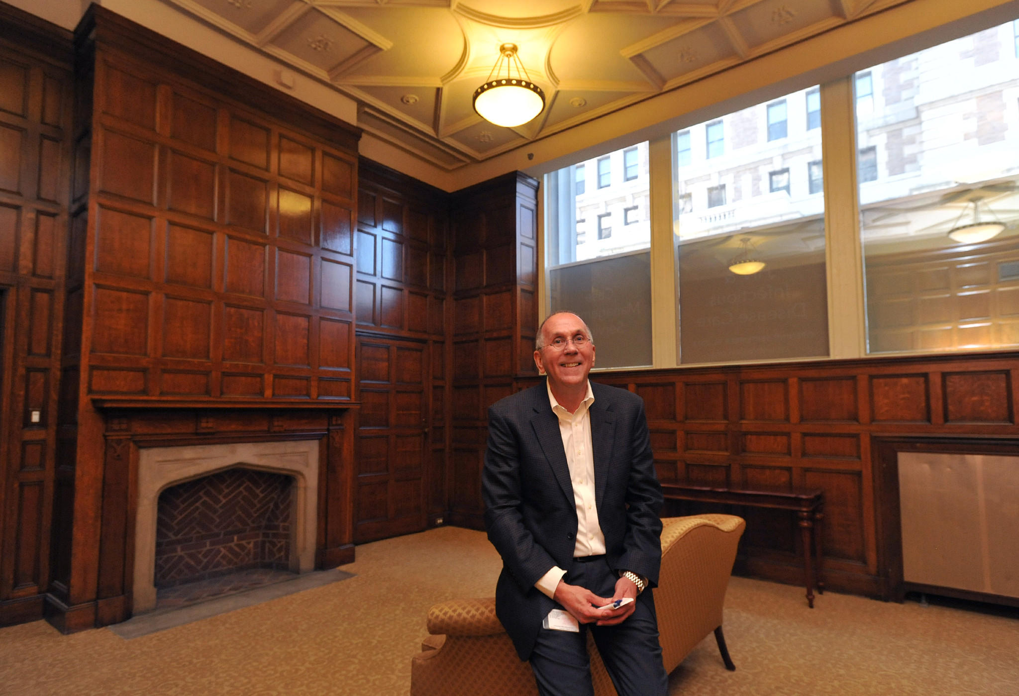 Richard L. Larison, CEO of Chase Brexton Health Services Inc., pauses in the former board room of Monumental Life. Amy Davis / Baltimore Sun Staff Photographer - #1080