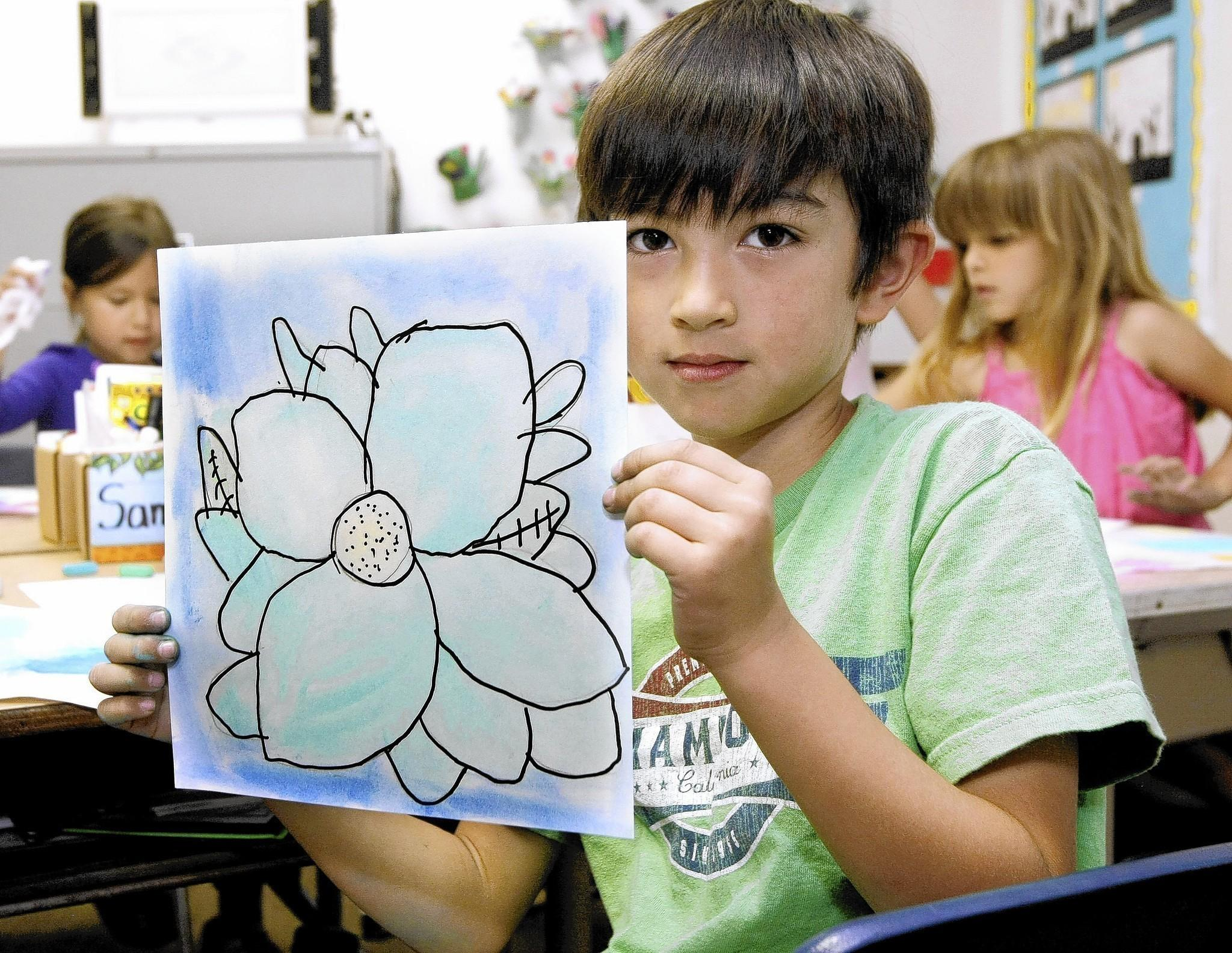 First grader Samuel Shorthouse used chalk pastels to create a flower inspired by artist Georgia O'Keeffe during art class at Stevenson Elementary School in Burbank on Thursday, May 1, 2014. The school was named a distinguished school.