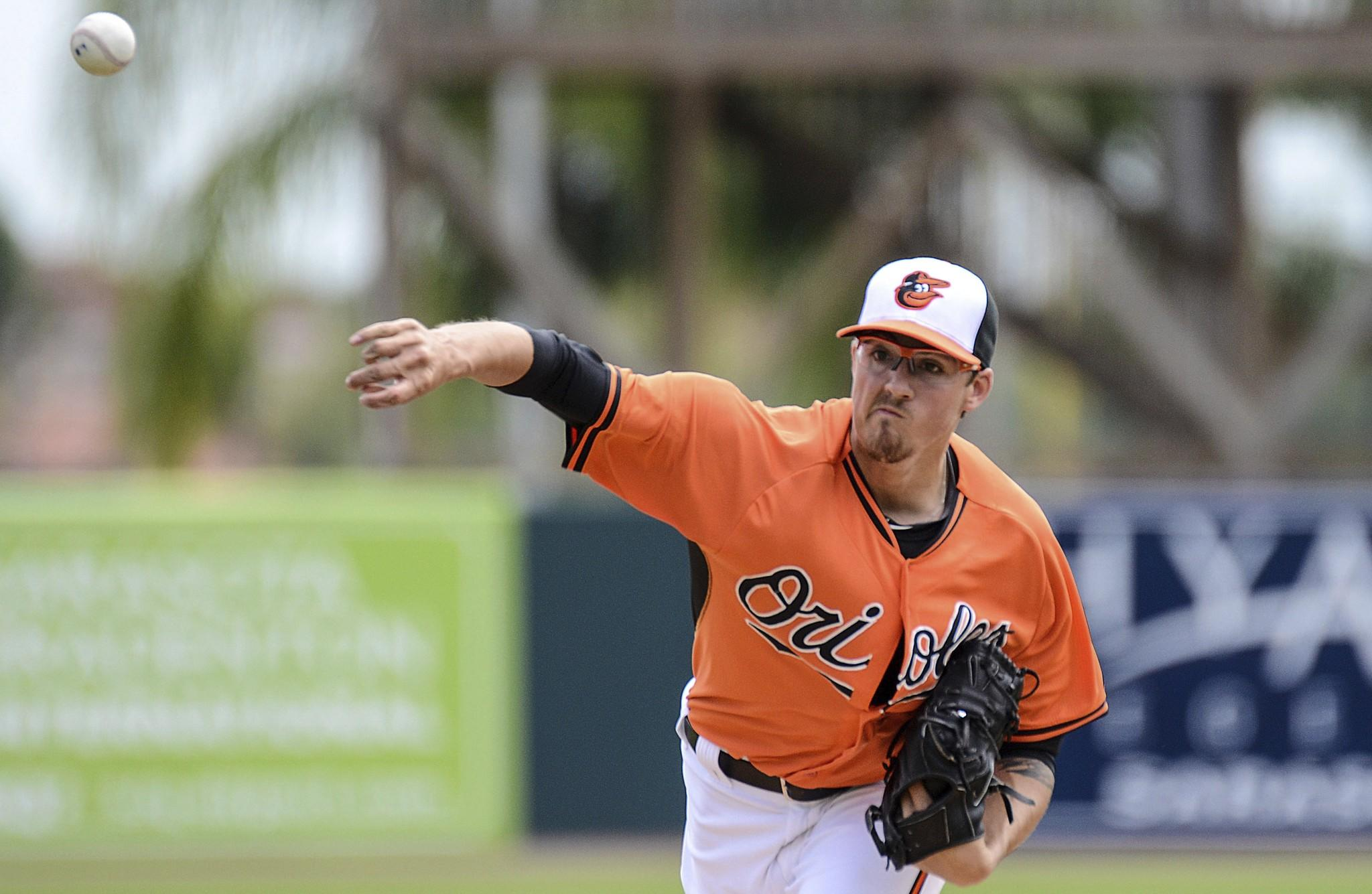 Orioles pitcher Kevin Gausman warms up at the start of the spring training exhibition game against the Pittsburgh Pirates at Ed Smith Stadium.