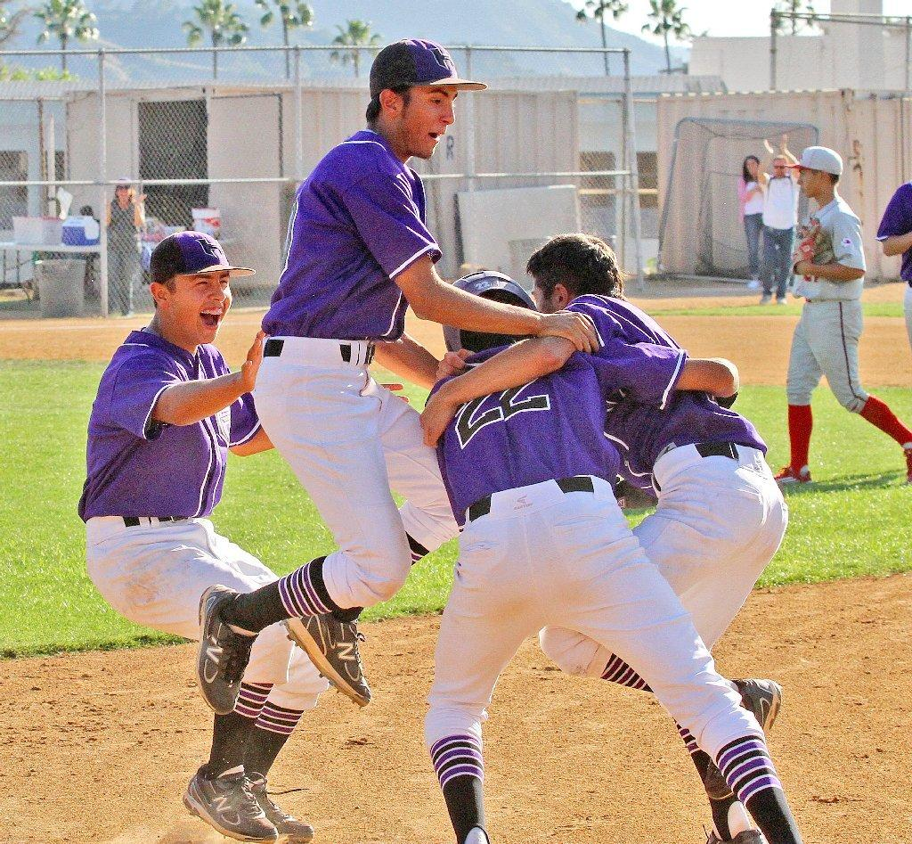 Hoover baseball celebrates its walk-off win over Burroughs on Friday.
