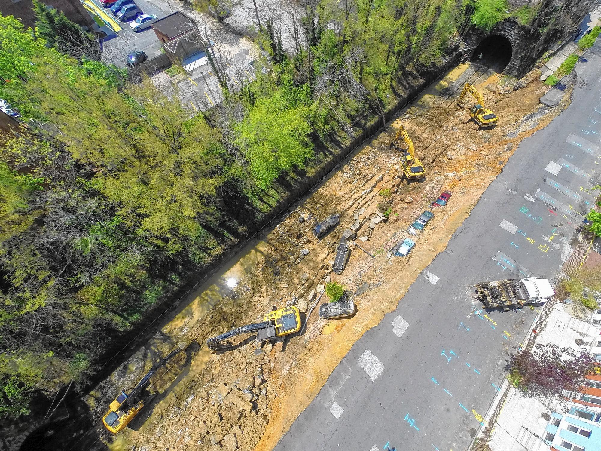 Aerial photos show the Charles Village landslide scene.