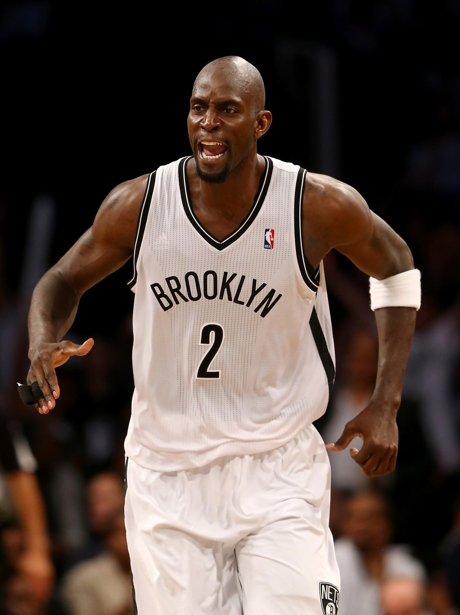 NEW YORK, NY - MAY 02: Kevin Garnett #2 of the Brooklyn Nets celebrates in the second half against the Toronto Raptors in Game Six of the Eastern Conference Quarterfinals during the 2014 NBA Playoffs at the Barclays Center on May 2, 2014 in the Brooklyn borough of New York City. NOTE TO USER: The Brooklyn Nets defeated the Toronto Raptors 97-83. User expressly acknowledges and agrees that, by downloading and/or using this photograph, user is consenting to the terms and conditions of the Getty Images License Agreement. (Photo by Elsa/Getty Images) ORG XMIT: 485876323