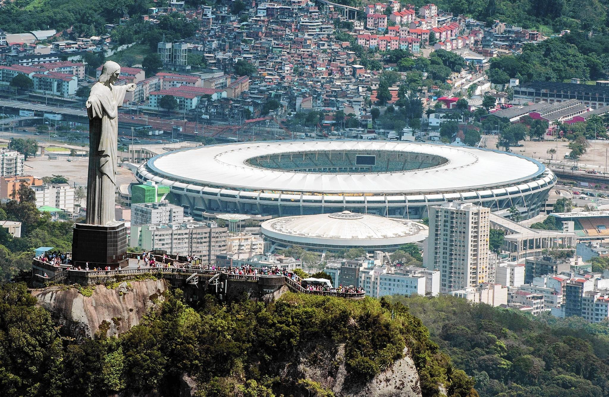 The Christ the Redeemer statue overlooks Maracana stadium in Rio de Janeiro, which will host the 2014 World Cup and the 2016 Summer Olympics.