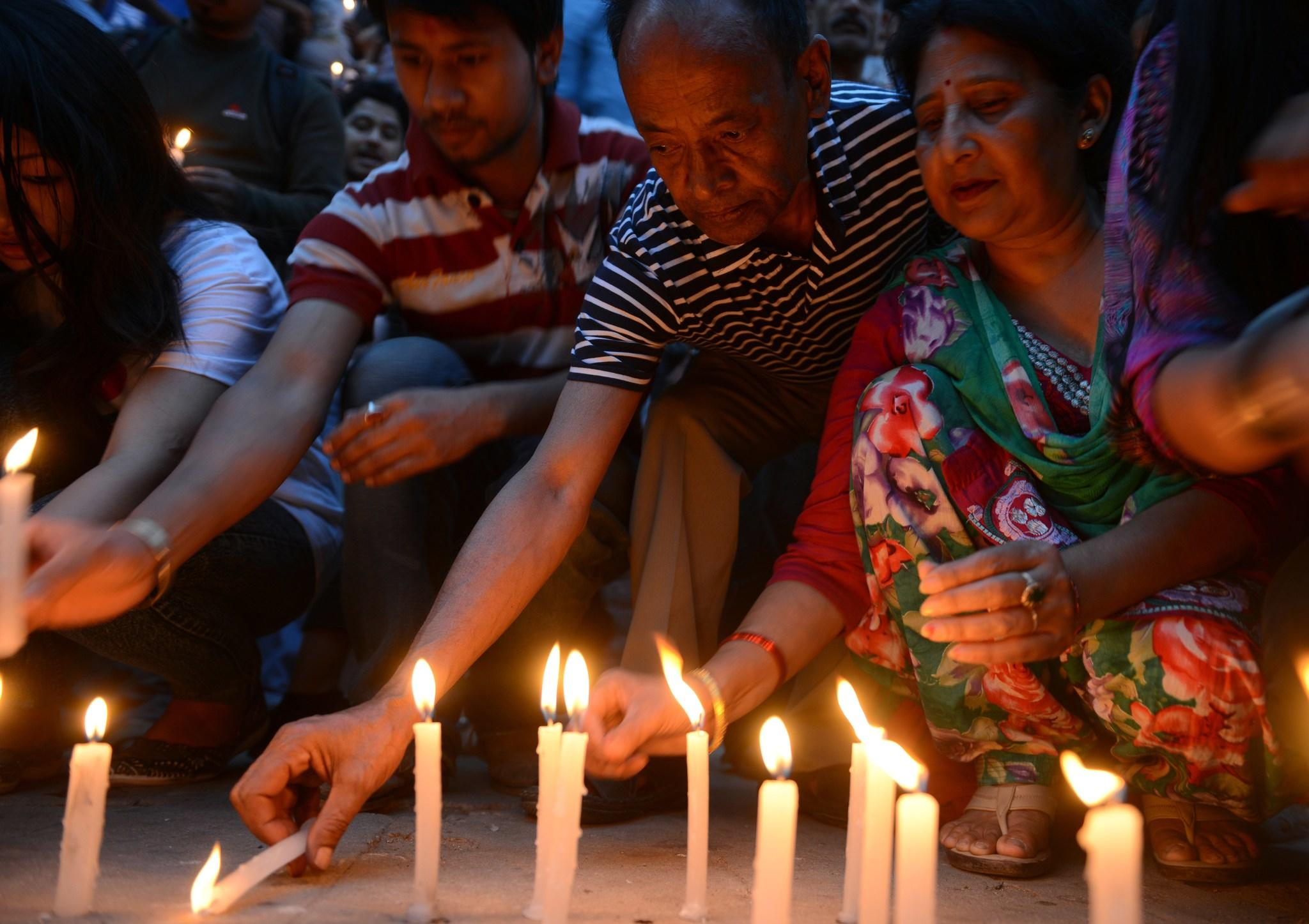 Nepalese people light candles in memory of the 16 Nepalese Sherpa guides killed in an avalanche on Mount Everest in Katmandu on April 30, 2014. An unprecedented shutdown of Mount Everest after the worst ever accident on the world's highest peak has left grieving Nepalese sherpa guides and their families fearing for their livelihoods. The avalanche on April 18 that tore through a group of sherpas -- who were hauling gear up the mountain for their foreign clients before dawn -- left 16 people dead and three others seriously wounded. AFP PHOTO/Prakash MATHEMA (Photo credit should read PRAKASH MATHEMA/AFP/Getty Images)