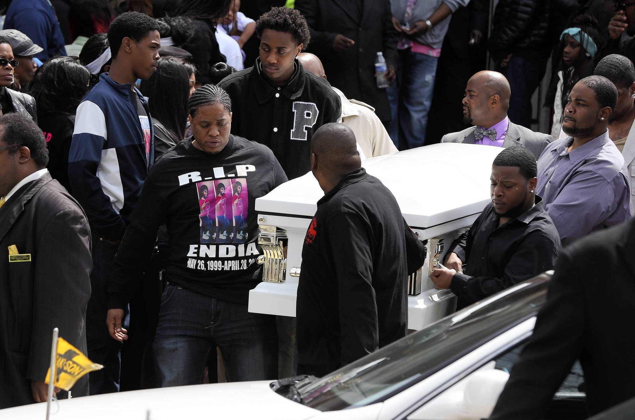 Endia Martin's casket is brought out of St. Andrews Temple in Chicago after her funeral.