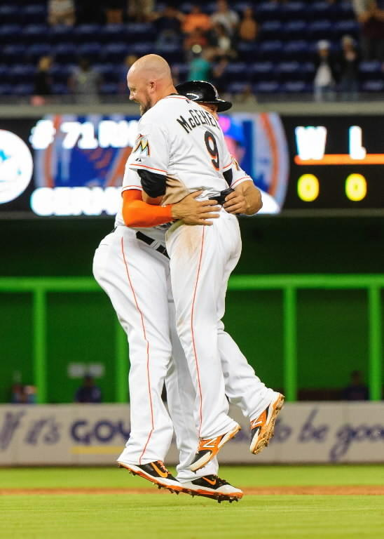 Miami Marlins right fielder Giancarlo Stanton (left) greets third baseman Casey McGehee (right) after McGehee hit the game winning RBI single in the ninth inning against the New York Mets at Marlins Ballpark.