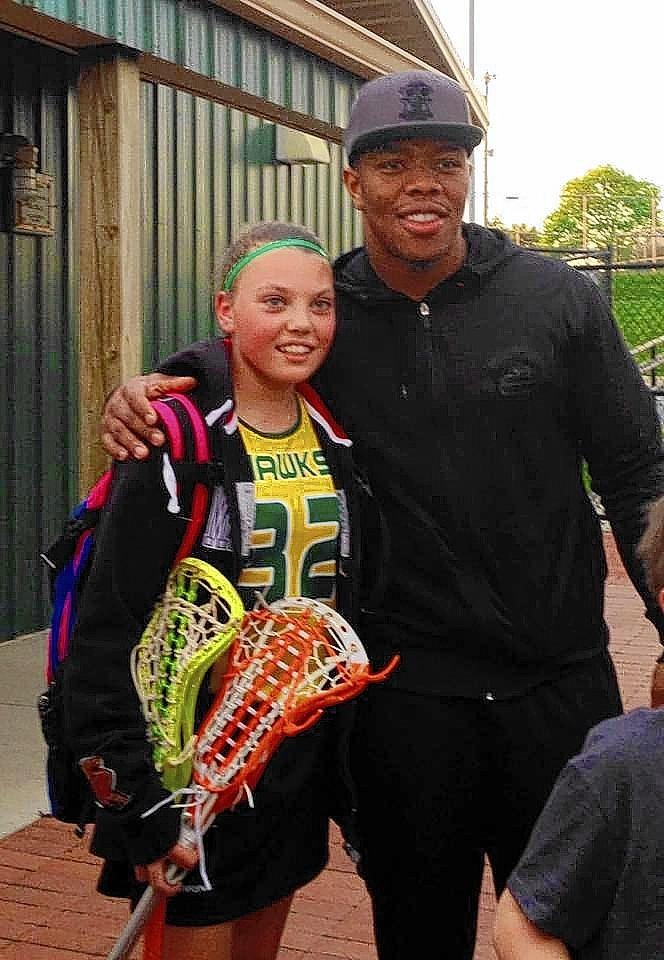 "Samantha Crone, 12, was ""super excited"" to pose for a picture with Batlimore Raven Ray Rice Monday evening before her rec lacrosse game at North Harford High School."