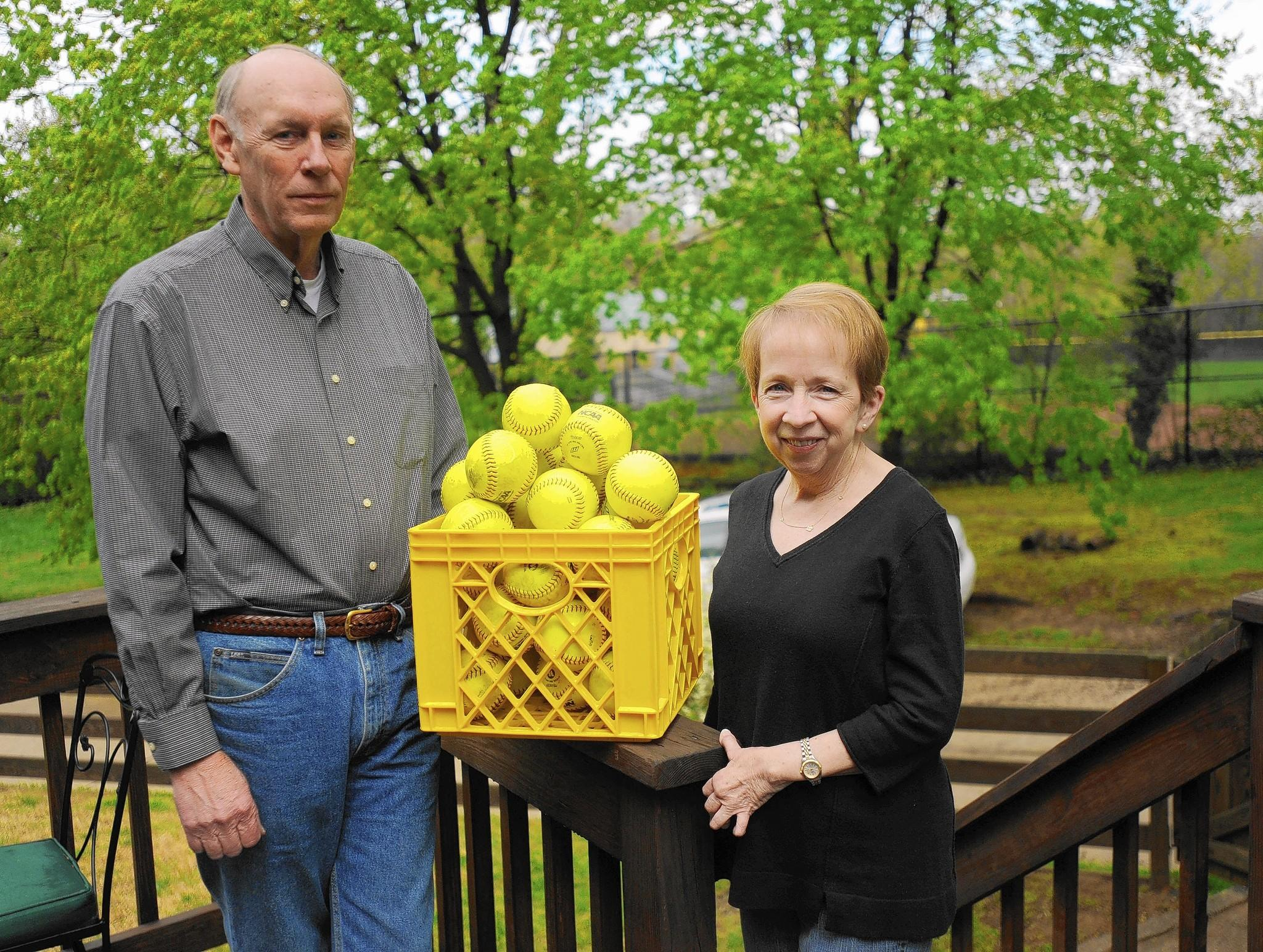 Jerry and Beth Truelove show the collection of softballs that have landed in or near their Stanmore Court yard in Rodgers Forge from adjacent Towson University. The Trueloves and some of their neighbors are negotiating with Towson University on a women's softball stadium planned at TU that they say will affect their quality of life.