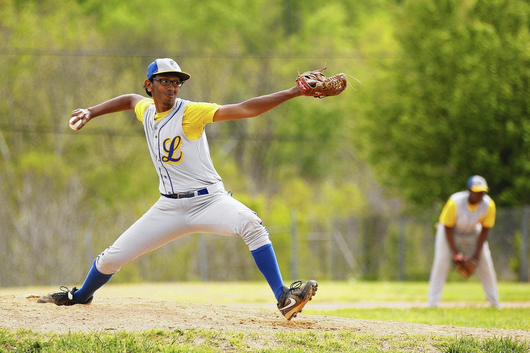 Laurel right-hander Nash Persaud pitches during the Spartans' 6-3 loss to Frederick Douglass on May 5.