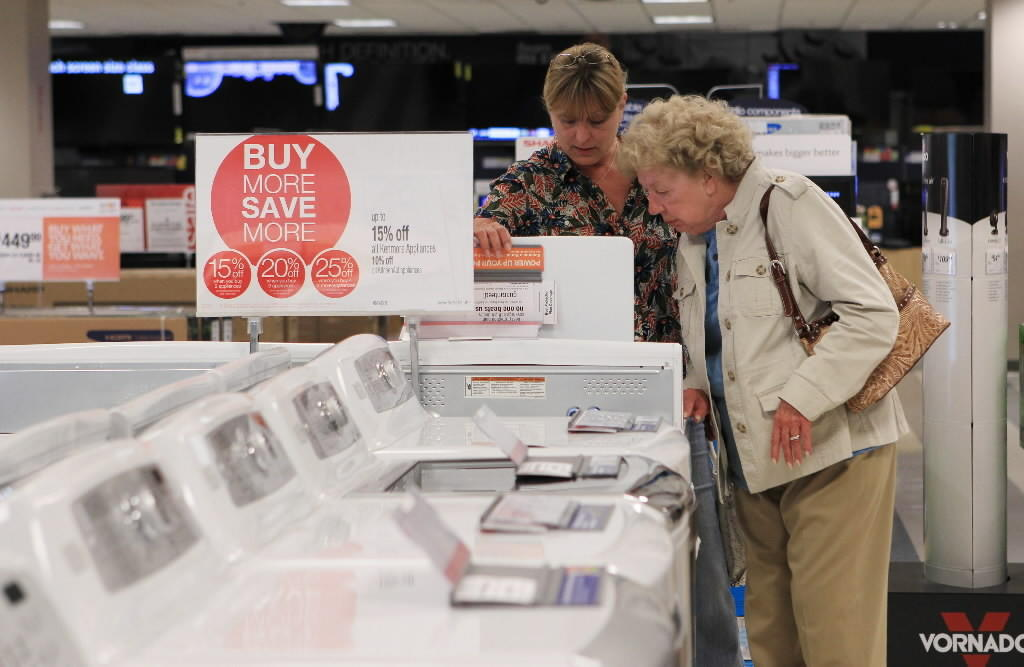 A shopper looks at washing machines in the Sears store at Woodfield Mall in Schaumburg in 2013.