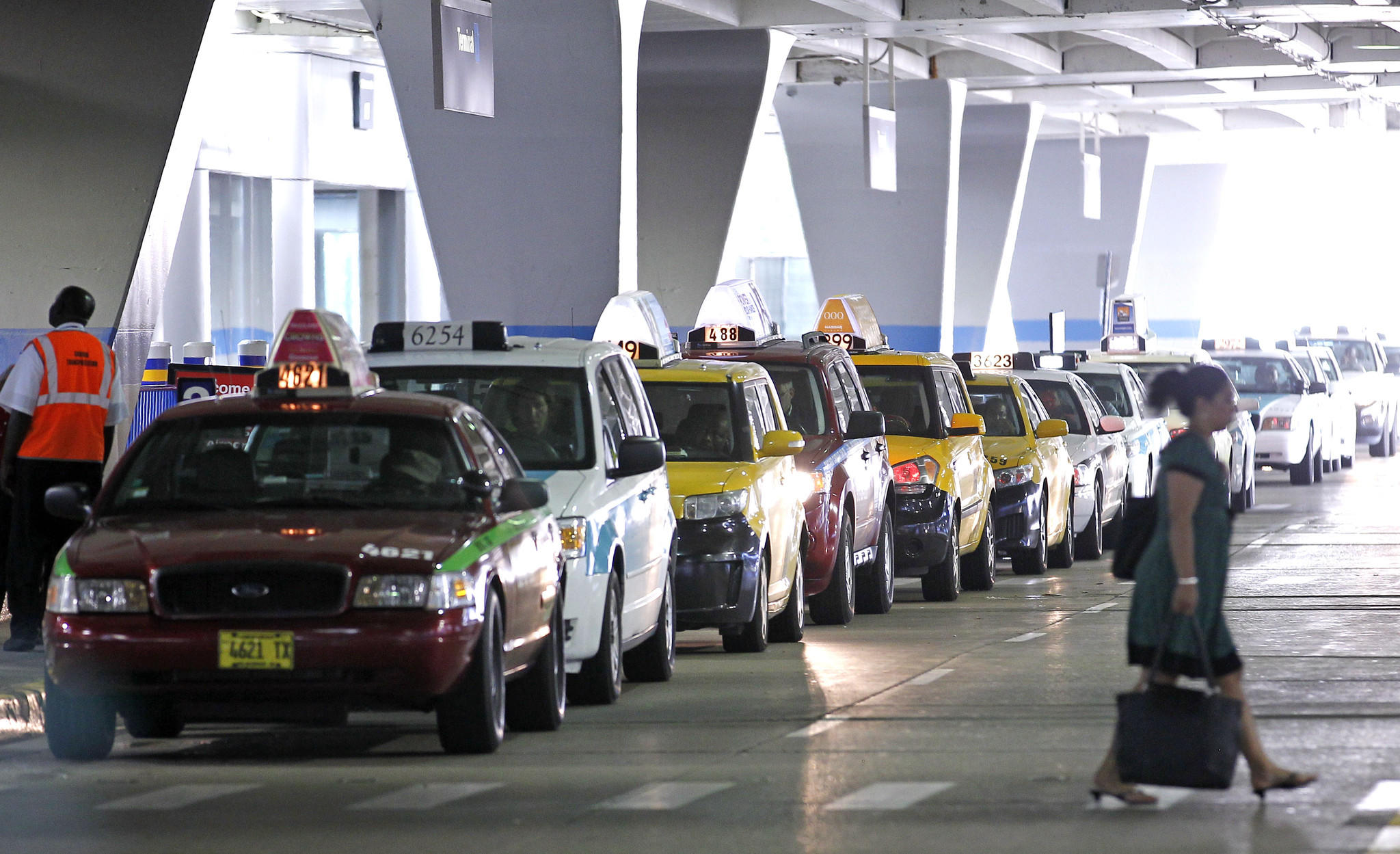 Taxis line up at a taxi stand at Terminal 1 arrivals area at Chicago O'Hare International Airport on Monday, July 2, 2012.