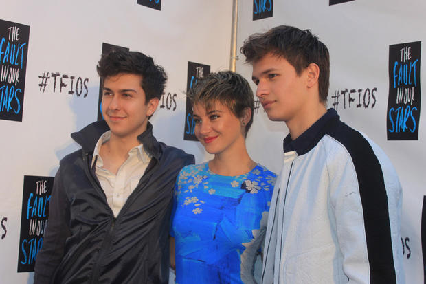 "Pictures of fans and actors of the upcoming movie at the red carpet for ""The Fault in Our Stars."""