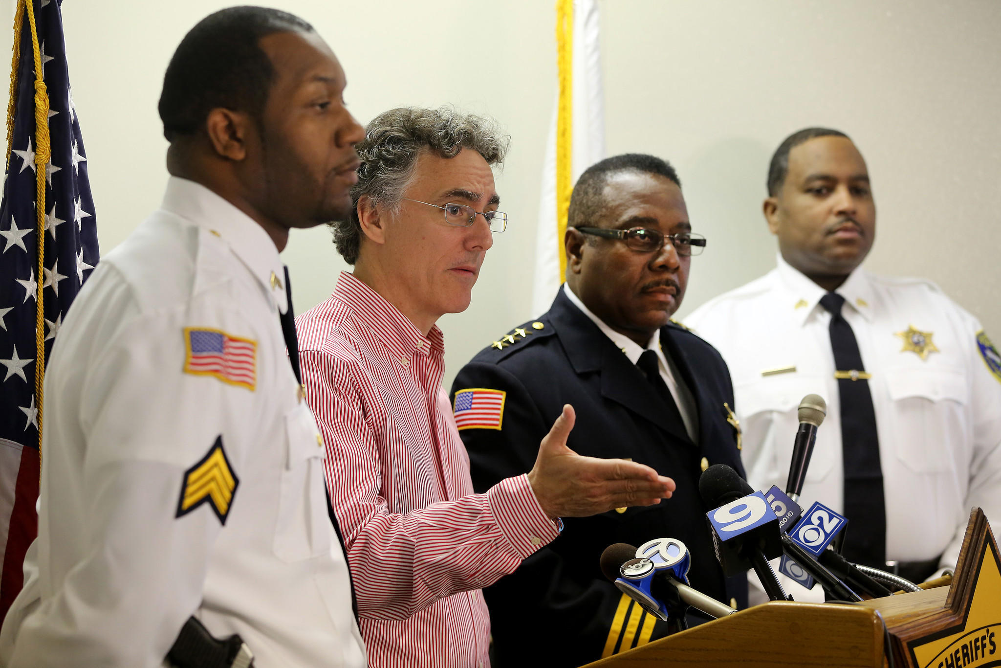 Cook County sheriff Tom Dart, second from left, and Dixmoor police chief Ronald Burge, second from right, announce the reopening of the investigation into the 1991 murder of 14-year-old Cateresa Matthews.