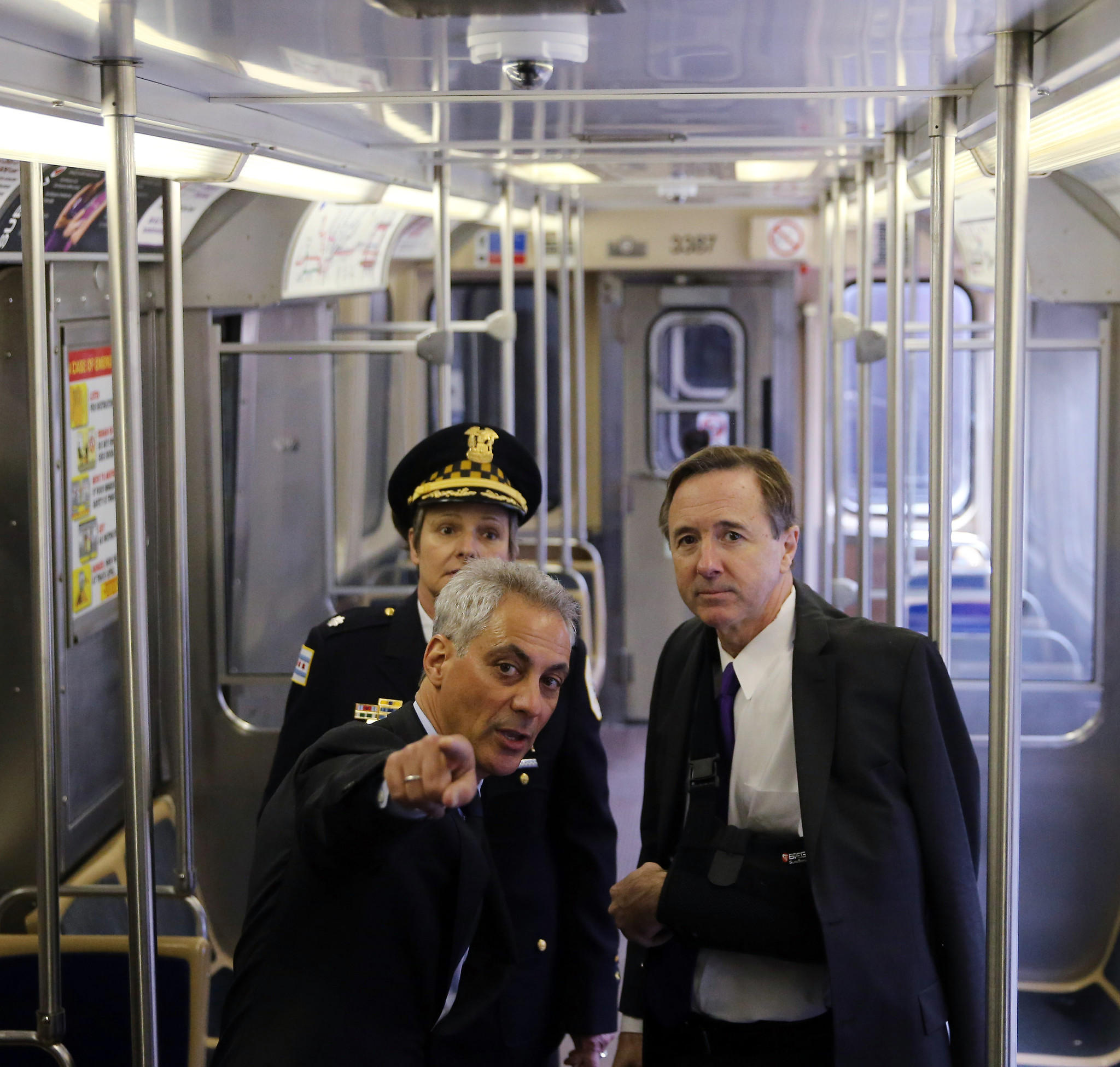 Mayor Rahm Emanuel, CTA President Forrest Claypool and Nancy Lipman, commander of the Chicago Police Department's Public Transportation Unit, discuss security cameras on a Brown Line train.