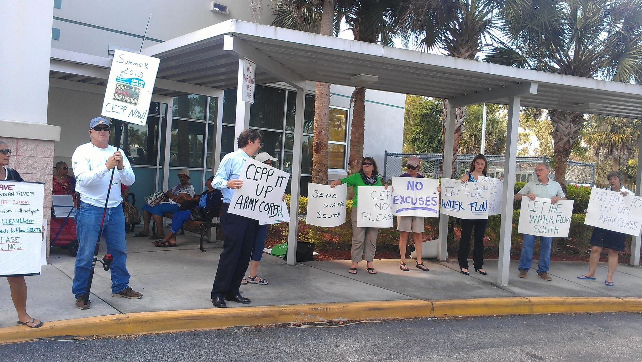 About a dozen protestors from the Sierra Club on Wednesday gathered outside of a meeting of state and federal officials in Royal Palm Beach, calling on them to reconsider the Central Everglades plan.