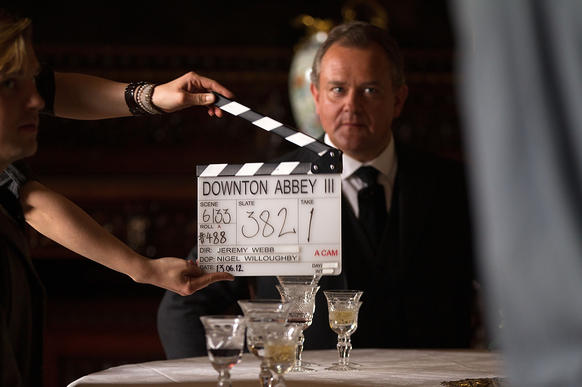 """Hugh Bonneville, who plays the Earl of Grantham, awaits the call of """"Action"""" during the filming of Season 3 of the hit period drama """"Downton Abbey."""""""