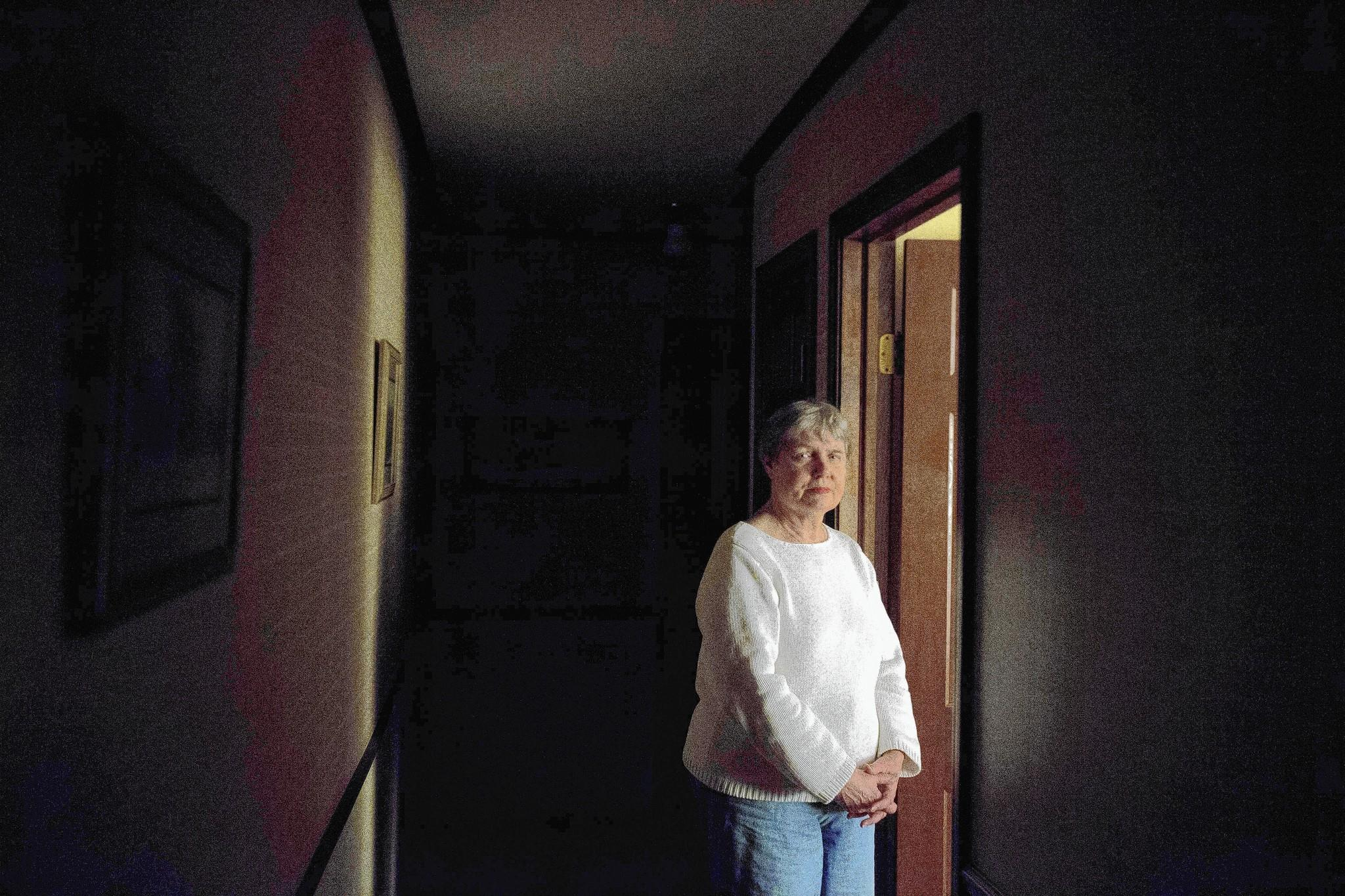 ComEd customer Judy Valentine keeps her Winfield home dark to save money, and she's concerned about rates that are set to rise.