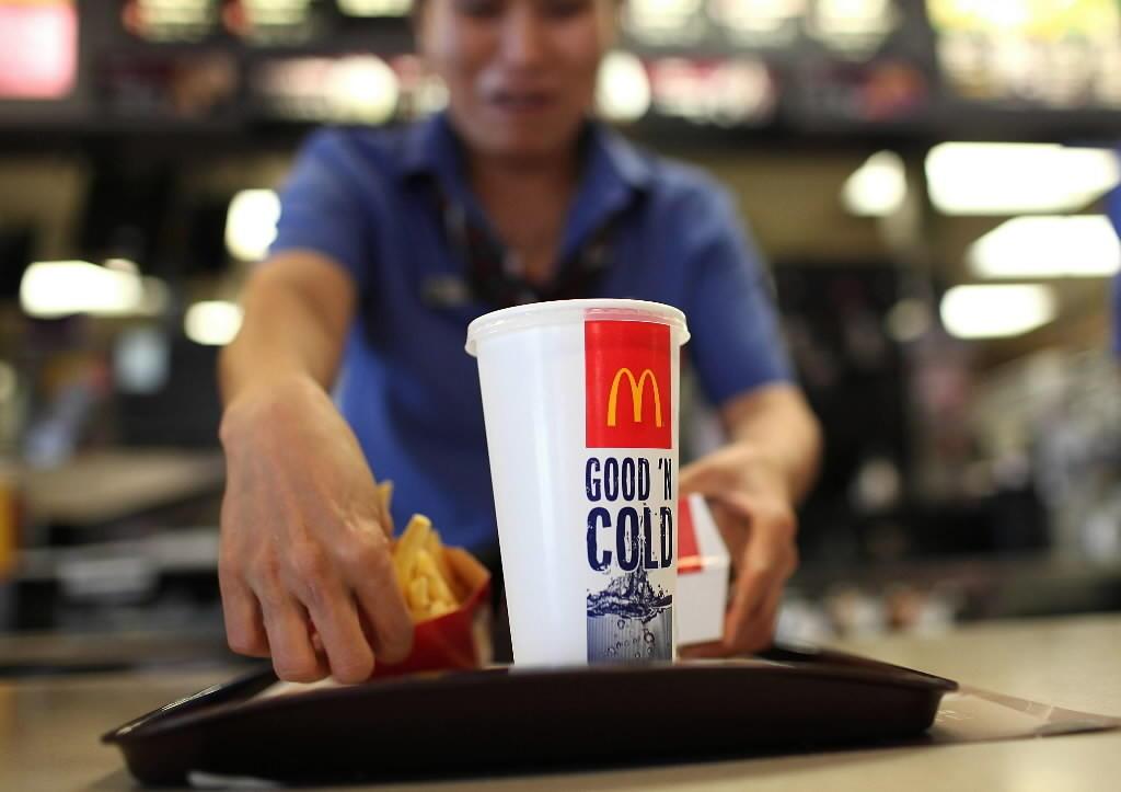 A McDonald's employee prepares an order.